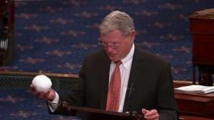 republican holding snowball climate change denier